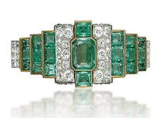 AN EMERALD AND DIAMOND BRACELET Of tiered design, centering upon a rectangular-cut emerald flanked on either side with pavé-set diamond bombé panels, to the three rectangular-cut emerald lines and pavé-set diamond bar link bracelet, 1930s, 16.0 cm, with French assay marks for platinum and gold