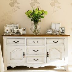 Cream vintage hallway A vintage-style sideboard adds extra storage in the hallway. Combine with a subtle floral wallpaper for a country feel. Wallpaper Laura Ashley Similar sideboard Laura Ashley  Read more at http://www.housetohome.co.uk/hallway/picture/cream-vintage-hallway#EGRmjJPOaQsil2O8.99