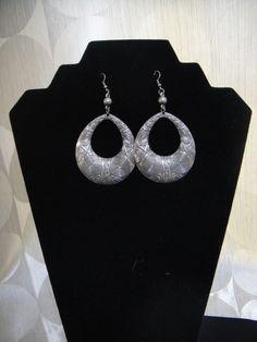 "Dull silver tribal print earrings.  4"" in total length"