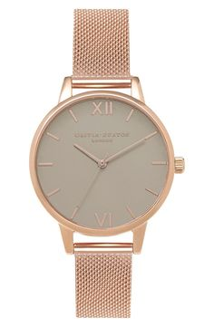 Two Roman numerals join slender hour indexes on this minimalist, monochrome round watch with an elegant rose gold mesh metal strap.