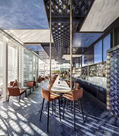 Winner of Tile of Spain Awards in the interior design category is the contemporary design of the Blue Wave Cocktail bar in Barcelona Spain.