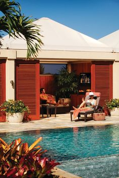 A couple enjoying a pool cabana at Four Seasons Resort Maui at Wailea
