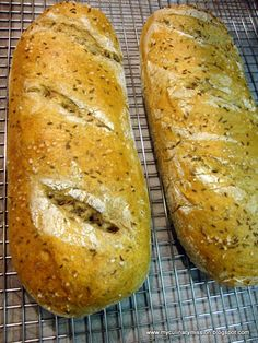 Eastern European Rye  Makes 2 large oval loaves     1 ½ Tbl active dry yeast  2 ¾ cups tepid water (80° - 90°F)  1 Tbl. sugar  1 scant Tbl salt  ¼ cup solid vegetable shortening  3 cups medium rye flour  2 Tbl finely ground caraway seeds (grind whole seeds in a spice     or coffee grinder)  1 ½ Tbl caraway seeds  3 ½ cups (approx) high-gluten flour, bread flour, or unbleached     all-purpose flour     Melted butter, for greasing the mixing bowl