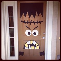 Front door Halloween decor! DIY Frankenstein I absolutely love this! I wonder if I could do it on my screen door (because that is in front of the actual front door)..hmmmm....