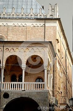 Photo made in the square of the fruit in the center of Padua in the Veneto (Italy). In the image you see, the part of the facade of the ancient and important building of reason on which stands out with its elegant colonnaded portico overlooking the square, the facade that faces west toward the Piazza dei Signori.