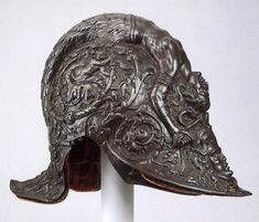 NEGROLI, Filippo  Parade Helmet  1543  Steel and gold, height 24 cm  Metropolitan Museum of Art, New York