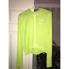 Hollister Large Lime Green Light Sweatshirt Lime green light zipper down hoodie. Terry cloth material on the inside. Very comfortable. Very light. Never worn, been sitting in my closet. Perfect condition. Not looking to trade. Price is negotiable if reasonable. Hollister Tops Sweatshirts & Hoodies