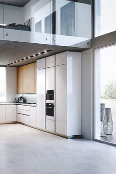 The frameless cabinets, sleek and simple hardware and strong horizontal lines are elements showcased in this modern loft kitchen.