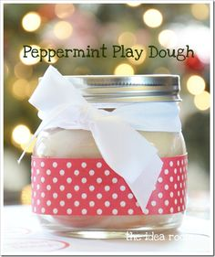 A great way to entertain the kids during Christmas break.  Or a great gift for a neighbor, classmates or friends.  It is so easy to make and is the softest (non sticky) Play Dough recipe I have ever used.  I like it better than the store bought stuff…plus…it smells amazing!!  And if you are feeling extra festive…throw in a handful of red glitter to give it some fun sparkle!