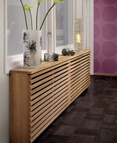 This horizontal, wooden cover is a great way to style up a radiator.