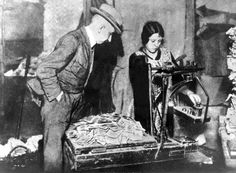 Mark notes are weighed by a woman in 1923: By then, the currency was worth little more than the paper it was printed on.