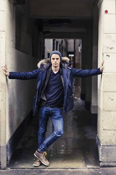 Matthew Goode - casual cool. Hat, dark blues, white t, fur hooded dark blue jacket.