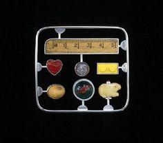 "Jack Cunningham - ""Kit"" series -  Memory Kit  Brooch 2003 - white metal, mixed media, readymade"