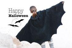 Abbiamo realizzato per Halloween un mantello con ali da pipistrello utilizzando una gonna nera con teli di velluto e con un fascione in jersey...