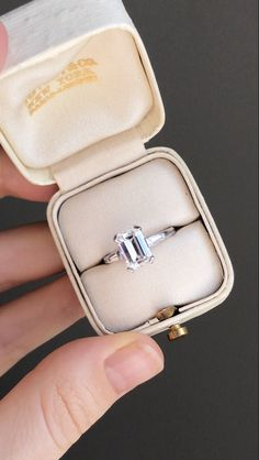This vintage engagement ring from the 1950's is set with a 1.66 carat D color rectangular cut solitaire.