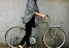 Iva Jean Bike: Rain Cape. The Rain Cape provides women with a stylish and functional solution for rain protection on and off their bike. Features such as the cord pull system, reflective piping, a high collar and billed hood make the Rain Cape a versatile option for bicycling in less than sunny conditions. Water resistant and waterproof options.