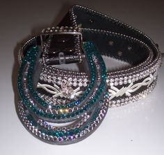 Horseshoes made into belt buckles  swarovski crystals attached. cowgirl-bling