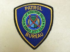 Until the late Houston Police officers' patches identified them by the bureau they worked in. Patrol Bureau patch under Chief Herman Short Houston Police, Police Patches, Law Enforcement, Police Officer, Porsche Logo, Investigations, Badges, Texas Law, Classic