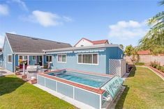 An Endless Pools swimming machine installed partially in-ground in a Lake Forest, California, backyard. Above Ground Pool Landscaping, Backyard Pool Landscaping, Endless Pools, California Backyard, Keep Swimming, Lake Forest, Pool Decks, Modular Design, In Ground Pools
