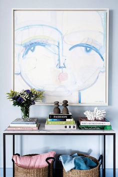 A pair of Sally King Benedict paintings, commissioned by Cohan, add a sense of whimsy to the entryway.