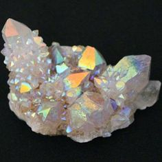 """These natural aqua aura quartz crystal cactus clusters are very hard to find. Size: About 2 to 2 1/2"""" long Pricing is per piece. Metaphysical Properties: This stone will balance and activate the chakr"""