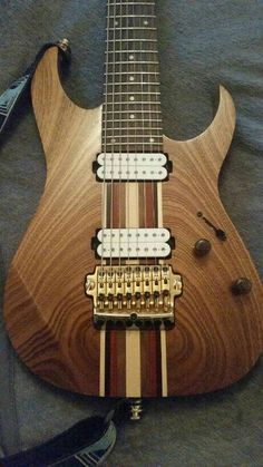 Ibanez RG2228 Custom... like the bookmatched body wings