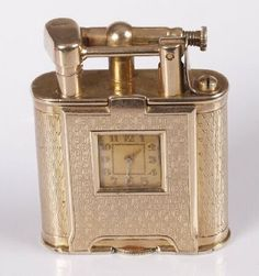 754: DUNHILL - 9ct gold petrol lighter, of engine turne : Lot 754