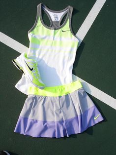 The Nike Dri-FIT Cotton Graphic Tank, the Nike Pleated Woven Skirt, and the Nike Zoom Breathe 2K12.