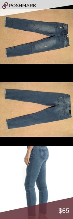 Jessie James Decker Blue Jean Baby Cue the drum roll...KITTENISH JEANS BABY! Keepin' it sleek-n-sexy, these soft stretch denim jeans feature mid-rise, button fly, custom oxidized black Kittenish metal shanks & rivets, black embossed leather patch and back patch pockets in tonal stitching. Effortlessly cool, these jeans have a vintage blue wash with slight distressing and a frayed hem. jessie james decker Pants Ankle & Cropped