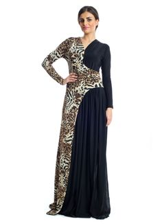 For that added touch of uniqueness to your casual look, this multi colored maxi dress from Xela makes a great buy. It features jersey fabric designed with black and leopard prints trimmed into a V-neckline with long sleeves to add that touch of elegance to every woman! This dress makes a great buy for casual events.