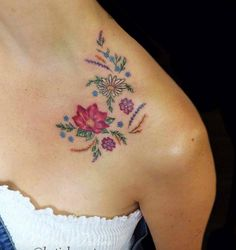 Tiny florals on collarbone by Katie Bee