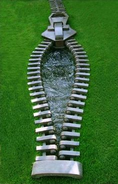 "This ""Zipped Water"" sculpture is by modern artist Mark Hall and is at the Modern Artist Gallery."