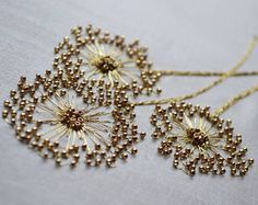 lovely--Etincelle Creative STUDIO: Course at Lesage in Paris - Salvabrani Bead embroidery stitches add sparkle to the ordinary – Artofit Learn the couture embellishment technique of tambour beading with world-renown experts, Hand and Lock, the company w Bead Embroidery Patterns, Tambour Embroidery, Couture Embroidery, Hand Embroidery Stitches, Embroidery Fashion, Embroidery Jewelry, Silk Ribbon Embroidery, Hand Embroidery Designs, Embroidery Techniques