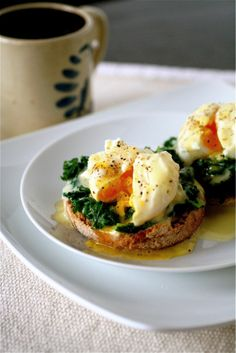 Poached eggs and sautéed kale on a whole wheat English muffin