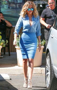 Khloe Kardashian in a denim shirt and pencil skirt - click ahead for more celebrity summer outfit ideas!