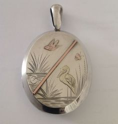 Fine Victorian Aesthetic Designed Sterling Silver & BI Colored Gold Oval Locket