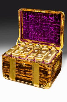 A fantastic and large coromandel ladies dressing case by Jenner & Knewstub, still retaining its original brown leather carrying case with the initials MIB, inside is a beautifully veneered case in coromandel which is brass bound and inlaid with recessed brass side carrying handles, opening the lid reveals a purple velvet lined interior with fifteen silver gilt cut glass bottles and containers