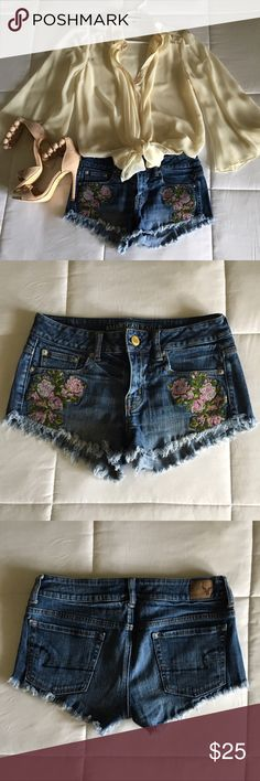"""American Eagle Embroidered Floral Shorts American Eagle Embroidered Floral Shorts  Approx Measurements: Waist 15""""(flat), Side Length 8"""", Inseam 2""""  **Shies in another listing** American Eagle Outfitters Shorts Jean Shorts"""