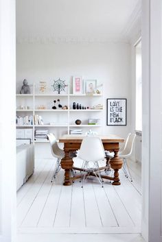 Eames chairs with Traditional Table