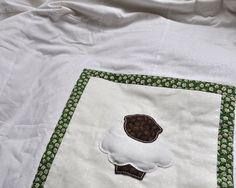The little lamb appliqué daisy print quilt creates a fresh and neutral bedding look, ideal for the modern nursery. This baby patchwork cot quilt is designed with a selection of tone on tone white cotton prints, features an adorable hand stitched appliqué lamb and is backed in soft brushed cotton. A light and comfy quilt for baby girls or baby boys, perfectly matched with the Lamb Daisy Cushion. Little Lamb Applique Daisy Print Patchwork Quilt £102