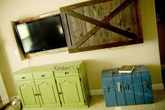 Sliding barn door TV cover! Great way to hide the TV.