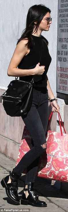 Great success: Kendall left the store with a sizable shopping bag in one hand...