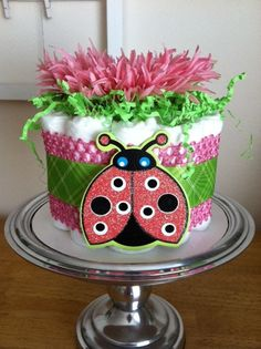 Inspiration. Pink and Green Ladybug Mini Diaper Cake - Baby Girl Shower Gift, Single Tier. $25.00, via Etsy.