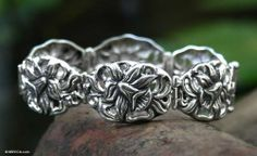 Bracelet, 'Silver Daffodils' NOVICA. $127.95. A fair trade product. Handmade by Priyo Salim.. Normally ships directly from Bali & Java within 10 days.. Save 52% Off!