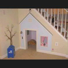 Boring old space under your stairs can be transformed into a playhouse for your kid(s)! So cute!
