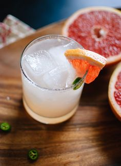 Skinny paloma cocktail spiced with serrano peppers. Ingredients include fresh grapefruit juice, tequila, club soda and agave nectar.