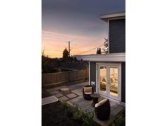 With its bedroom tucked into the lower level, this Vancouver laneway house has plenty of views of the Vancouver cityscape and mountains. Vancouver, House Design, Outdoor Decor, Room, Home Decor, Bedroom, Decoration Home, Room Decor, Rooms