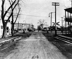 Today's Flashback Friday Photo is from 1922 looking north from South Union Avenue at the Central Railroad grade crossing. The train station can be seen at right side across the tracks.