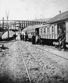 Local History: All aboard Hawley's gravity rail coaches - A PA Coal Company gravity passenger train waits to board passengers at Hawley, at the foot of the first inclined plain, No.13. The train coasted from Dunmore to Hawley by the force of gravity, and left being pulled back up on a cable. The PCC gravity railroad operated from 1850 to 1885.