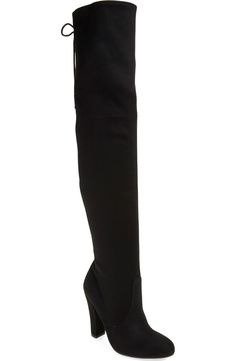Instantly add a dramatic touch to any look with these over-the-knee boot featuring a lush, sueded finish. Corset-inspired back laces perfect the fit while dialing up the retro allure.